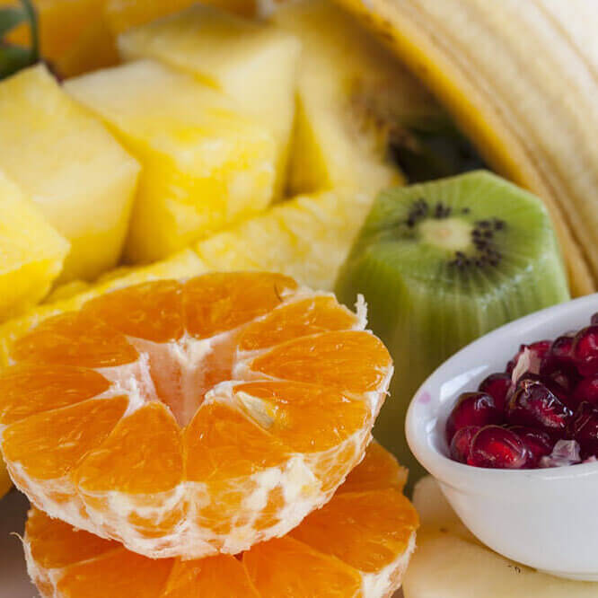 Picture of healthy fruits - kiwi, orange, pineapple, banana